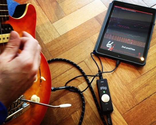Playing Guitar Rabbit with an electric guitar through iRig PRO on an iPad